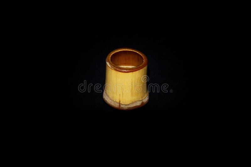 Copo de bambu pequeno para a causa bebendo imagens de stock royalty free