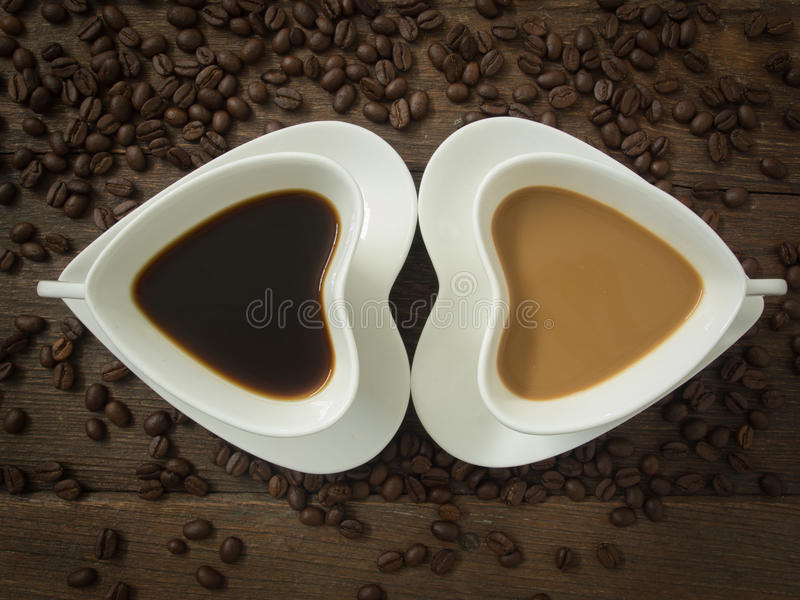Copo de café com coração imagens de stock royalty free