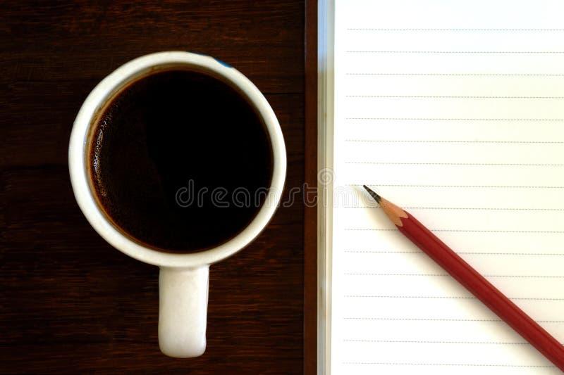 Copo de café e papel de nota imagem de stock