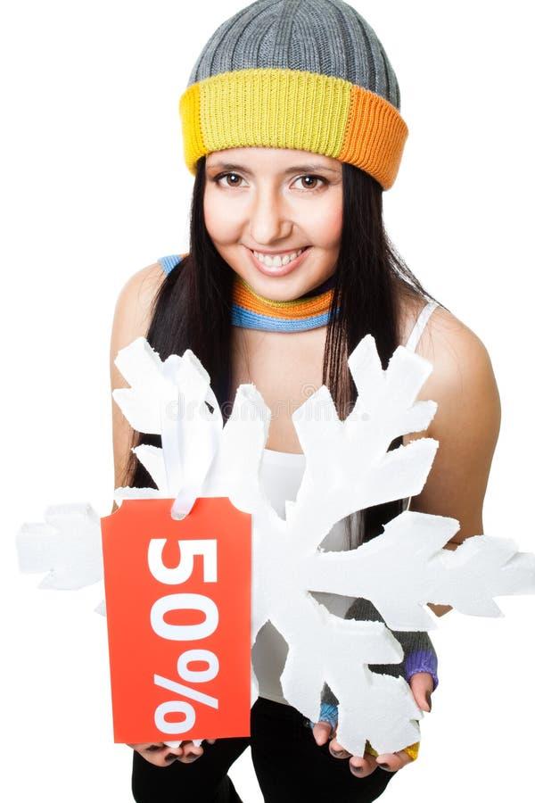 Copo de nieve del asimiento de la mujer con la etiqueta de la venta fotos de archivo libres de regalías