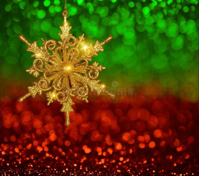 Copo de nieve del oro de la Navidad imagenes de archivo