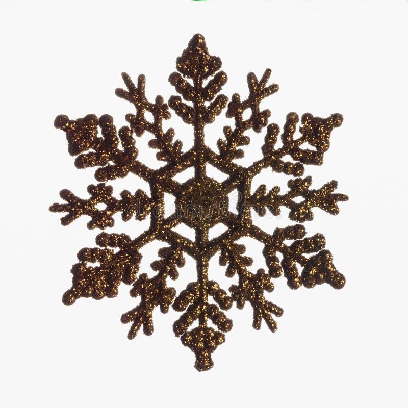 Copo de nieve de oro de la Navidad aislado en el fondo blanco imágenes de archivo libres de regalías