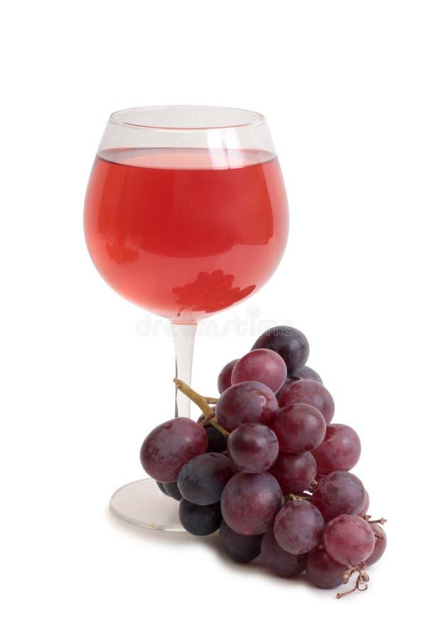 Copo de vinho e uvas de grupo imagens de stock royalty free