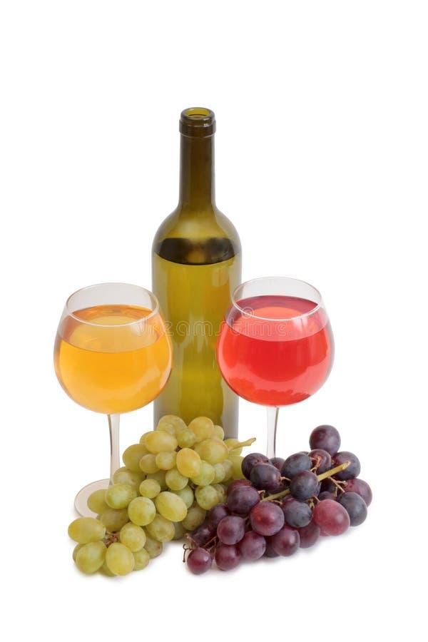 Copo de vinho e uvas três fotos de stock