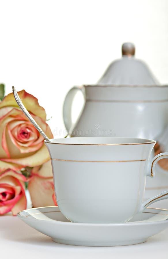 Copo do chá e do teapot imagem de stock