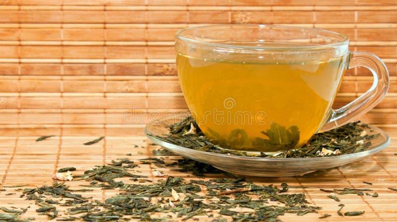 Copo do chá verde fotografia de stock