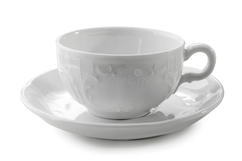 Copo e pires de chá da porcelana isolados no fundo branco imagens de stock