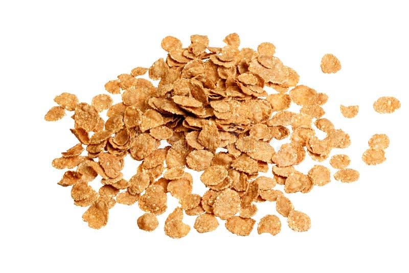 Copos de maíz, cierre del cereal para arriba en el fondo blanco foto de archivo