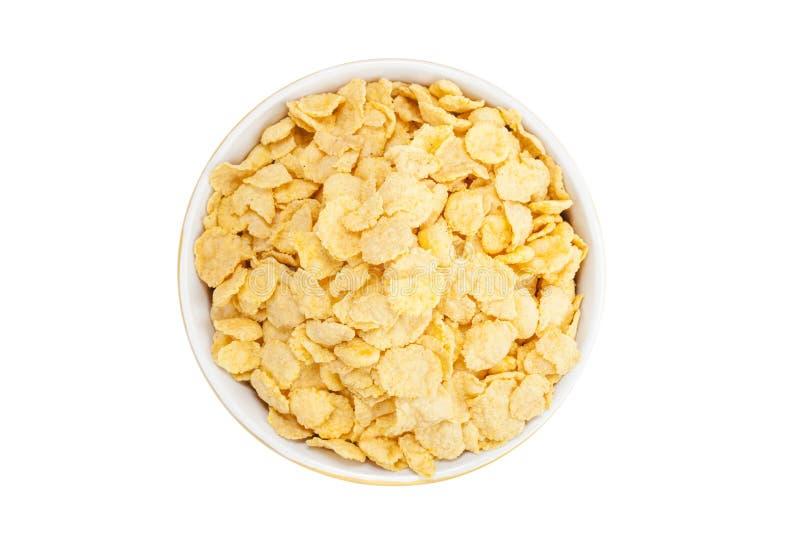 Copos de maíz del cereal en un cuenco imagen de archivo