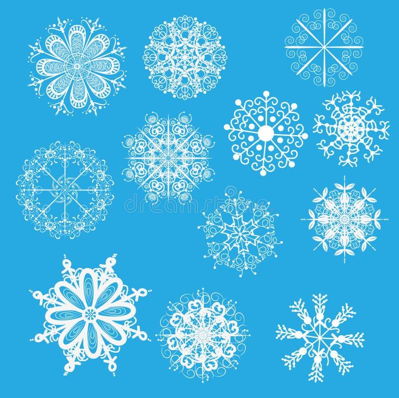 Copos de nieve blancos en un fondo azul fotos de archivo libres de regalías