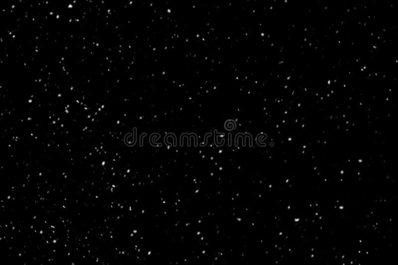 Copos de nieve en fondo negro fotografía de archivo libre de regalías