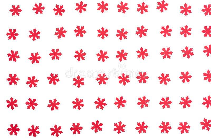 Copos de nieve rojos hermosos en el fondo blanco imagen de archivo