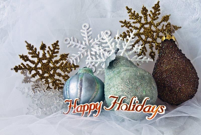 Copos de nieve y ornamentos de la Navidad foto de archivo