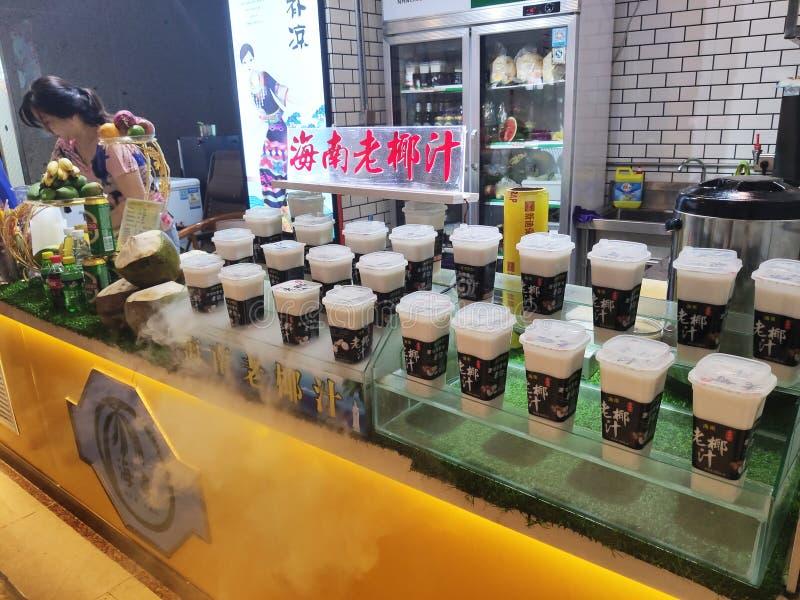Copos frios do leite de coco na loja fotografia de stock royalty free