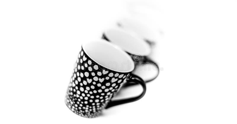 Copos modernos pequenos do café isolados no fundo branco - café, café fotografia de stock royalty free