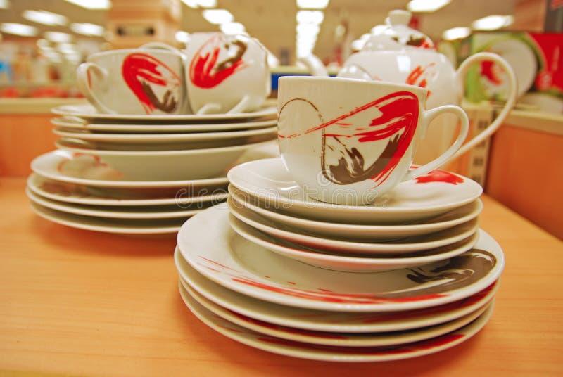 Copos, pires e placas de chá imagens de stock royalty free
