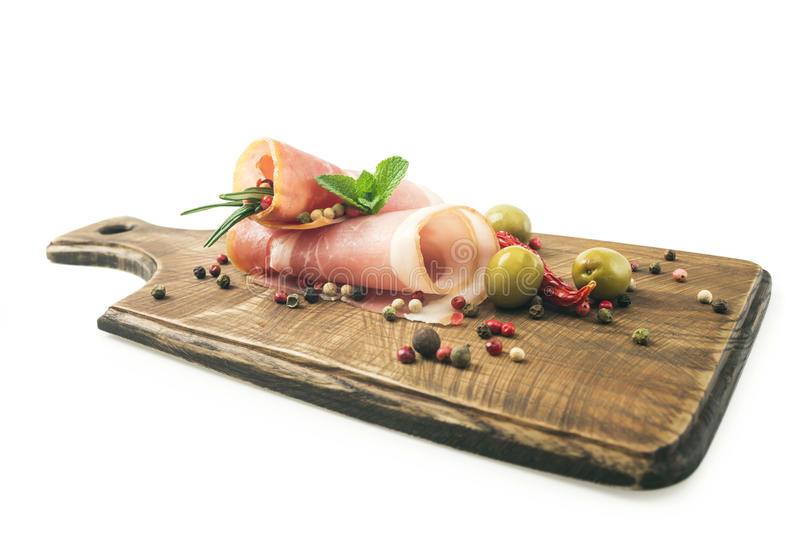 Coppa pork collar ham. Cold cuts on wood. royalty free stock image
