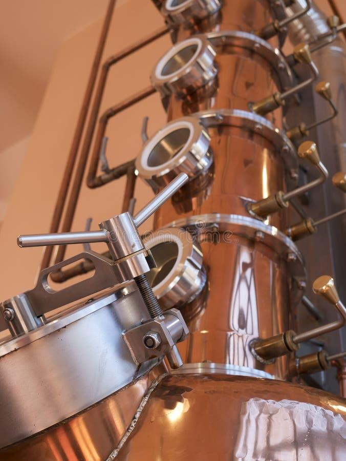 Copper alembic still. Alembic still for making alcohol inside distillery, destilling spirits royalty free stock image