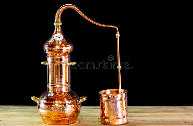 Copper alembic. To distill alcohol and oils royalty free stock image