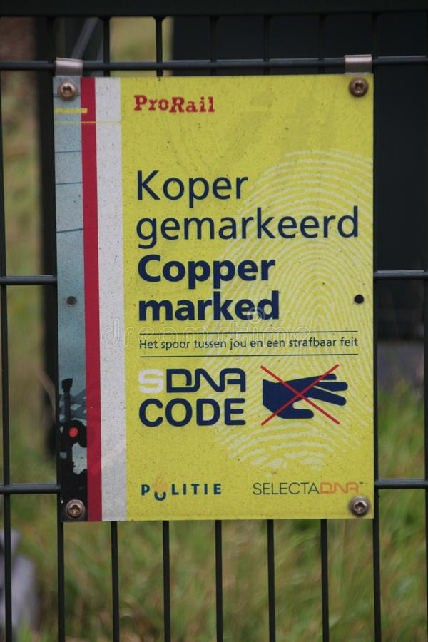 Copper along the railroad is marked with DNA code marker royalty free stock photo