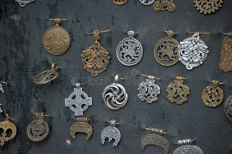 Copper amulets. Medieval copper amulets for sale royalty free stock photo
