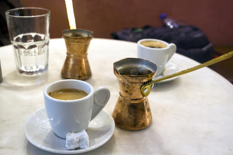 Copper coffee pots and greek coffe, sweet loukoumi on the small dish. Taken in Athens stock photography