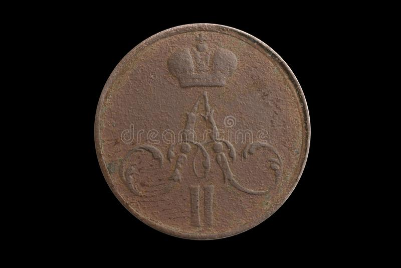 A copper coin of the Russian Empire money of 1857 on a black isolated background royalty free stock image