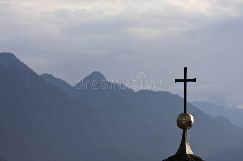 Copper cross against Lienzer Dolomites stock photography
