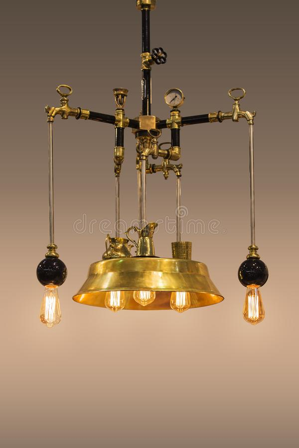 Copper design chandelier, golden color lamp, handmade from bronze, in steampunk style, isolated stock photo