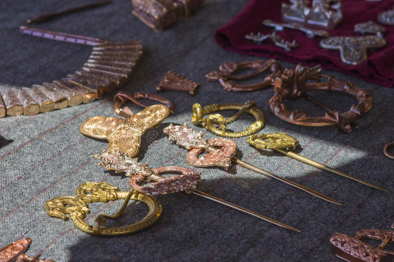 Copper ethnic jewelry barrettes, buckles, brooches. On the counter of the ethnic store for the reenactors stock photos