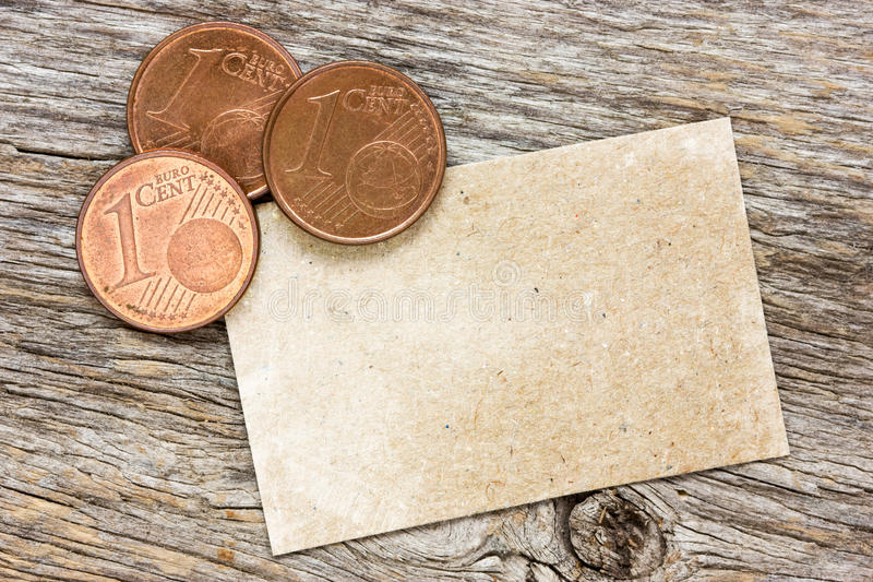Copper euro cents with paper card. For your text royalty free stock photo