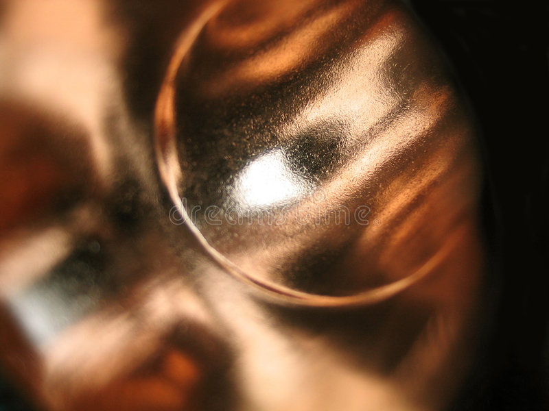Copper face. Can almost see a face in the copper elbow used in construction stock photo