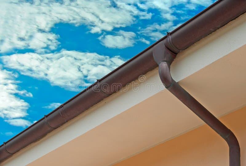 Copper gutter. Under a cloudy sky stock photos