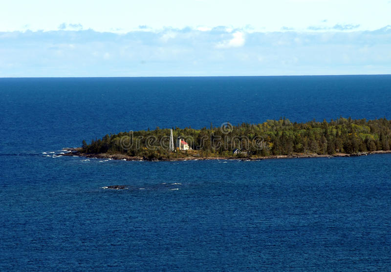 Copper Harbor Lighthouse. Sits on tip of the Keweenaw Peninsula. It is surrounded by the blue water of Lake Superior stock images