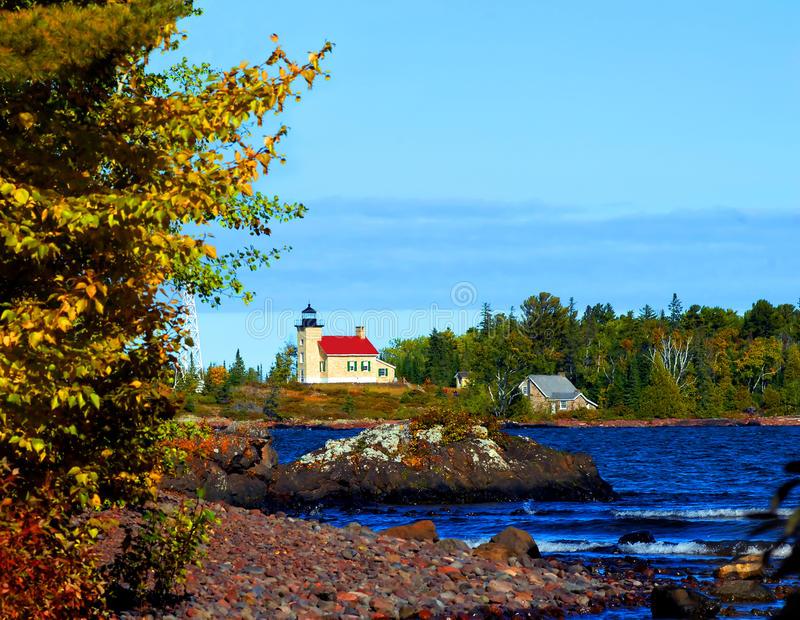 Across Copper Harbor. Copper Harbor Lighthouse sits at the tip of the Keweenaw Peninsula in Upper Peninsula, Michigan. Visitors can be seen walking the steps to royalty free stock images