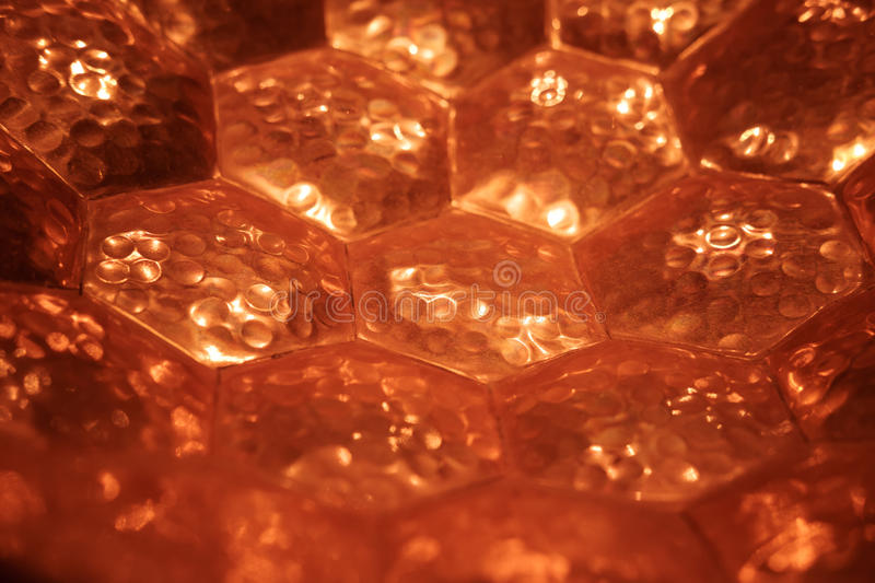 Copper hexagon pattern background royalty free stock image