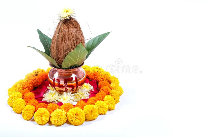Copper Kalash with coconut , leaf and floral decoration on a white background. essential in hindu puja. Copper Kalash with coconut , leaf and floral decoration stock photo