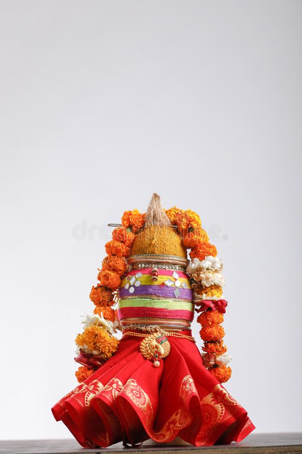 Copper kalash with coconut and mango leaf with floral decoration.  royalty free stock photography