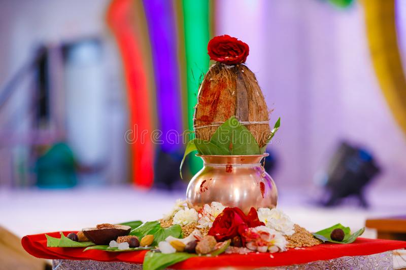 Copper kalash with coconut and mango leaf with floral decoration.  stock photo