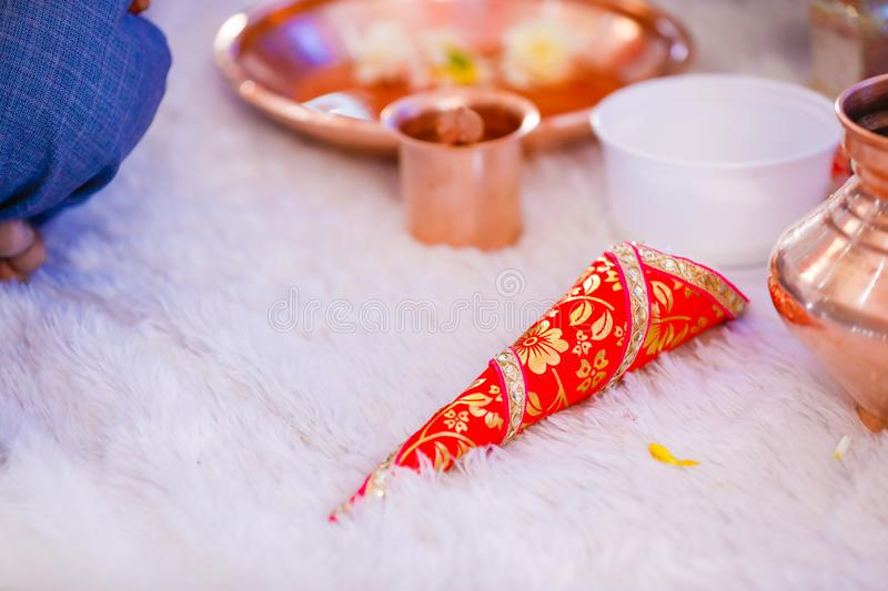 Copper kalash with coconut and mango leaf with floral decoration.  stock photography
