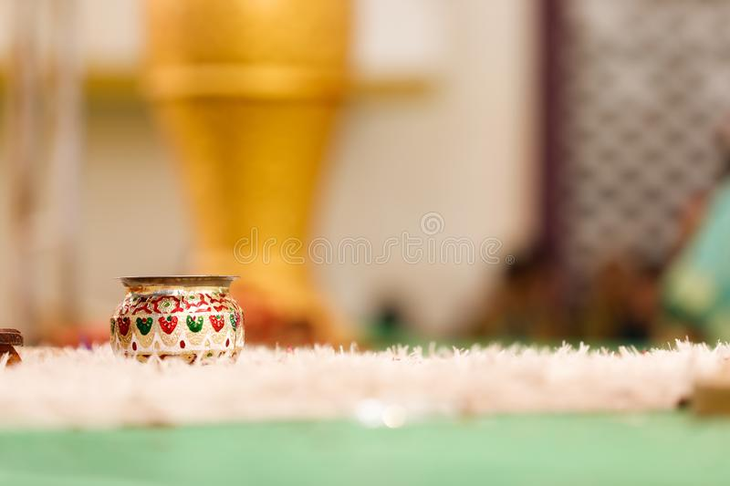 Copper kalash with coconut and mango leaf with floral decoration.  stock images