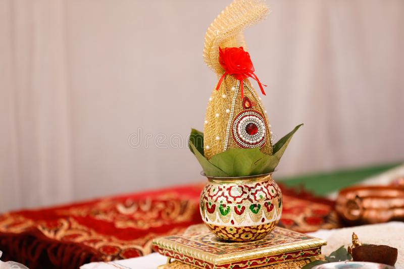 Copper kalash with coconut and mango leaf with floral decoration.  stock photos