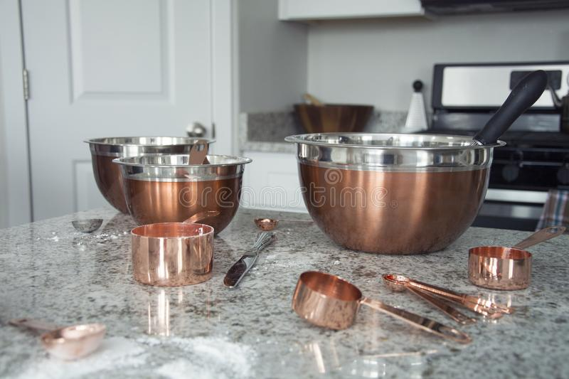Copper measuring cups and bowls royalty free stock photography