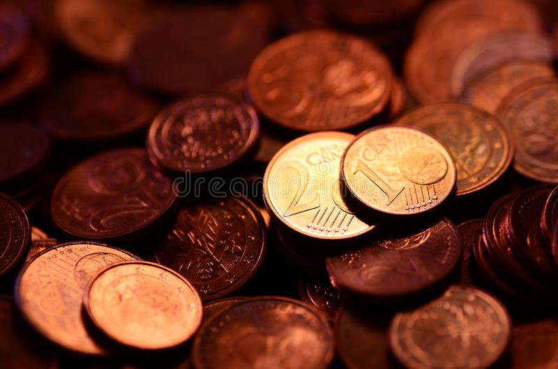 Copper money in 2 and 1 euro cents. And change stock photography