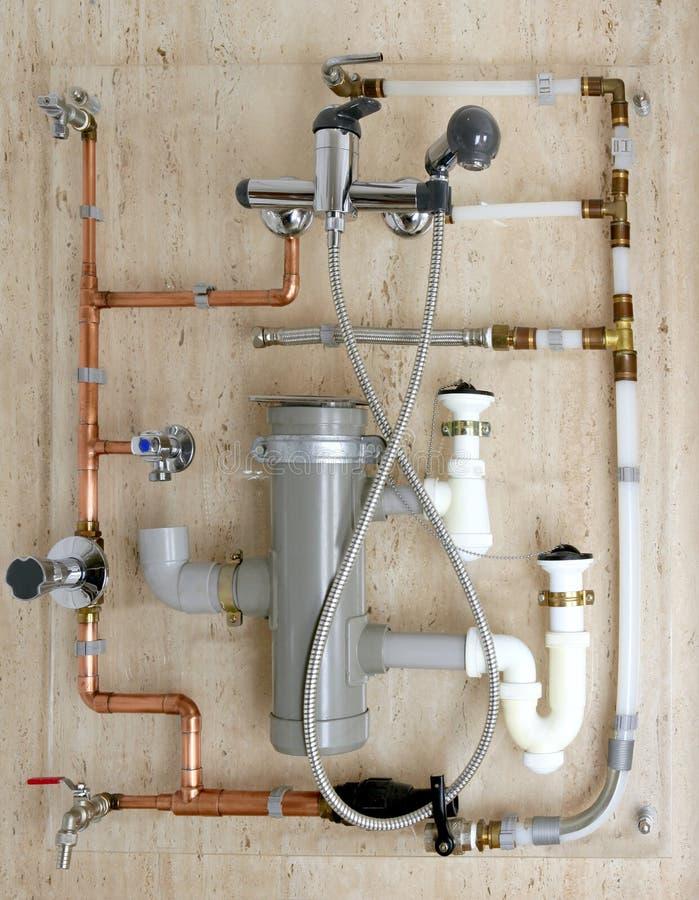 Copper plumbing installation and polyethylene pvc. Diagram stoves valves drain royalty free stock photo