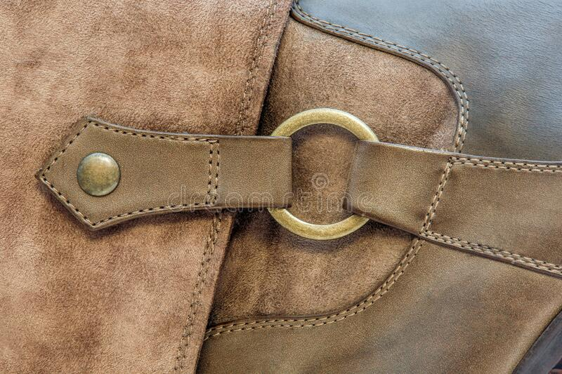 Copper ring on a leather boot stock photos