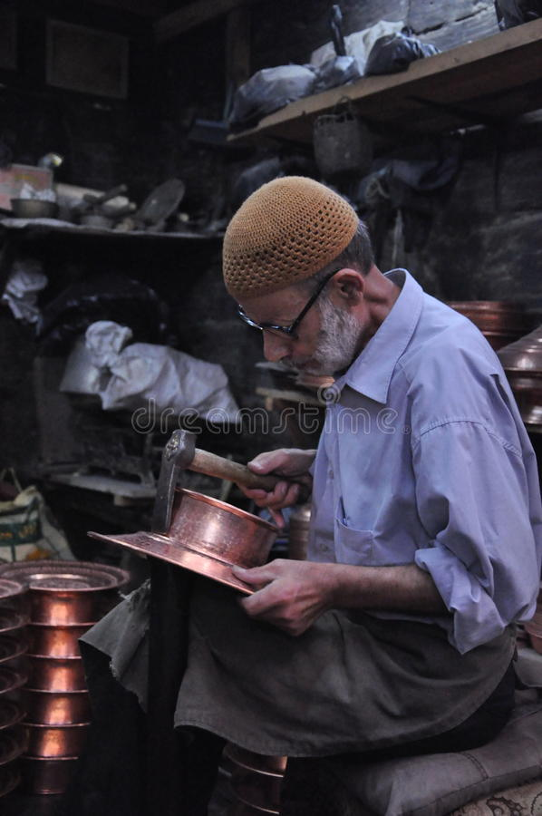 Copper smith at work editorial photography image