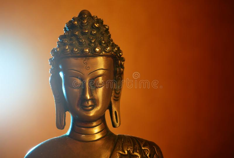 Statuette of Buddha. Copper statuette of Buddha, Buddha`s face close-up royalty free stock photo