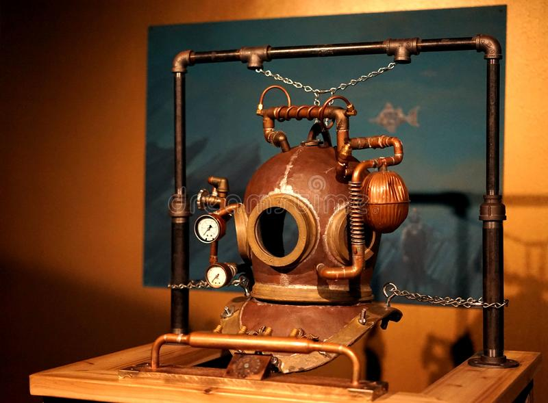 Copper Steampunk diving helmet. Steampunk is a genre of science fiction with a historical setting and steam-powered machinery rather than advanced technology stock image