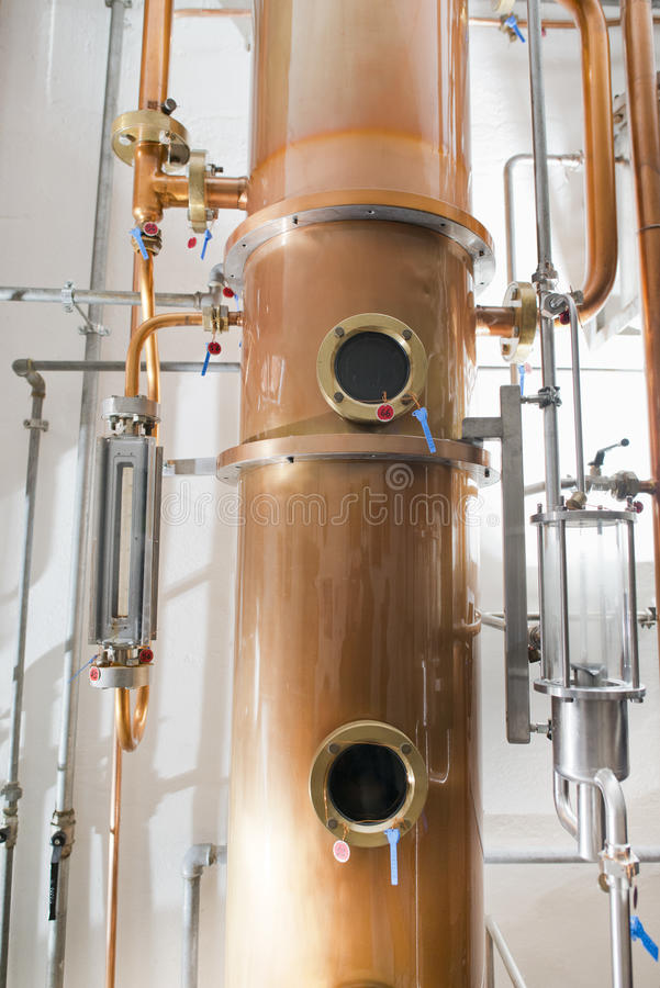 Copper still alembic inside distillery. To distill grapes and produce spirits stock photos
